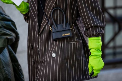 guest-is-seen-wearing-neon-gloves-mini-jacquemus-bag-news-photo-1568608358