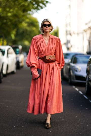 guest-wears-sunglasses-a-pink-pleated-dress-a-chloe-brown-news-photo-1568606908